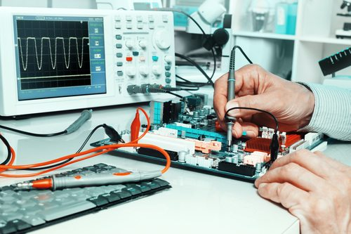 Tech tests electronic equipment